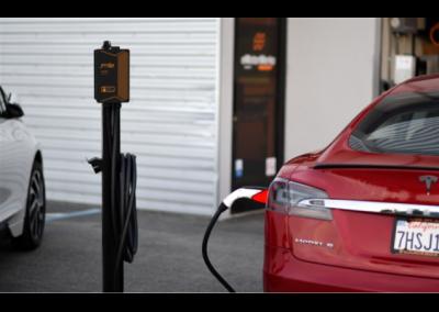 JuiceBox Pedestal charging a Tesla